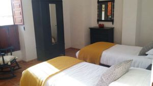 Twin room with modern decor at our spanish bikers holiday accommodation