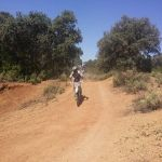 Riding spanish trails on an off-road motorcycle.